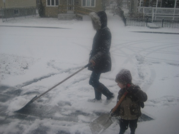 Oscar and Elizqbeth shovelling snow