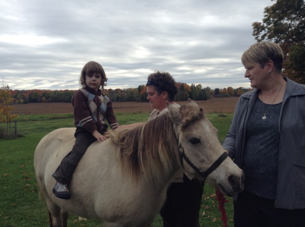 Oscar on a pony with Erica and Allison