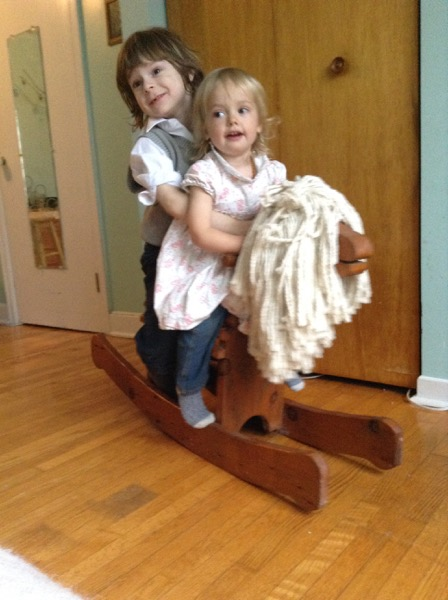 Viv and Oscar on a rocking horse
