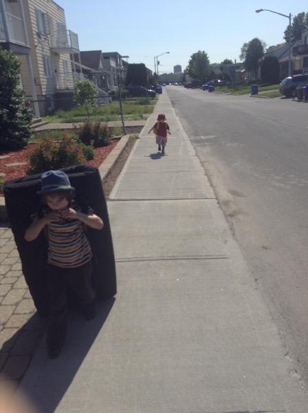 Oscar carrying crash mat and Viv follwing