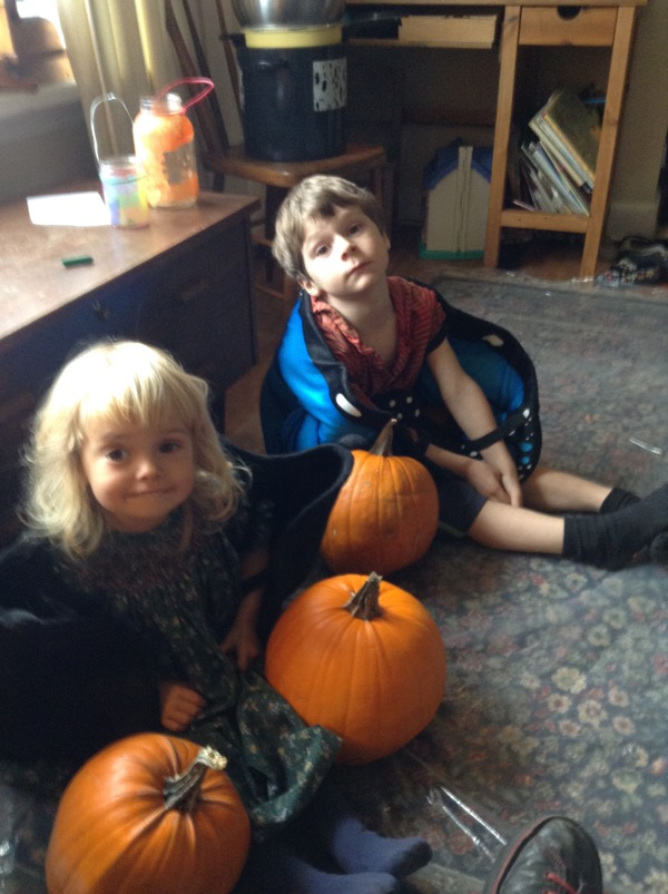 Oscar and Vivien in play wings with pumpkins.