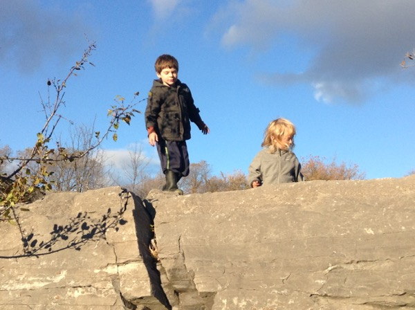 Oscar and Vivien at the top of a cliff.