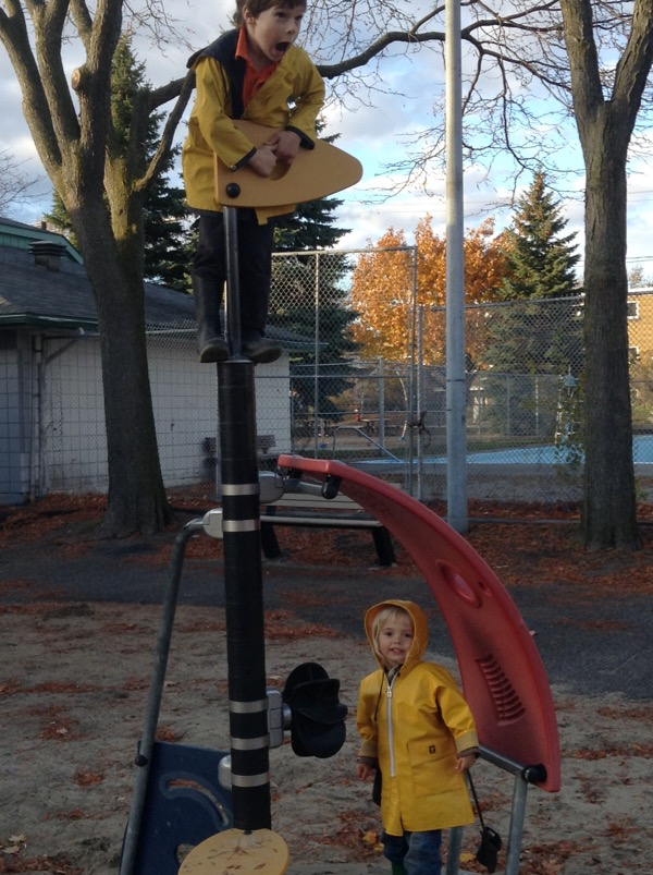 Oscar up high and Vivien down low on a vaguely maritime play structure.