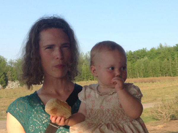 Elizabeth and Ada in a field, with dinner roll.