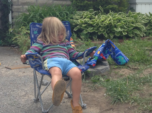 Viv lounging in a camp chair.