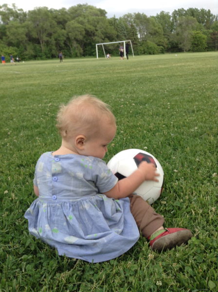 Ada with a soccer ball in a field.