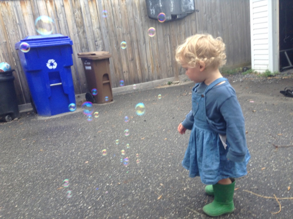 Two-year-old Ada with bubbles.