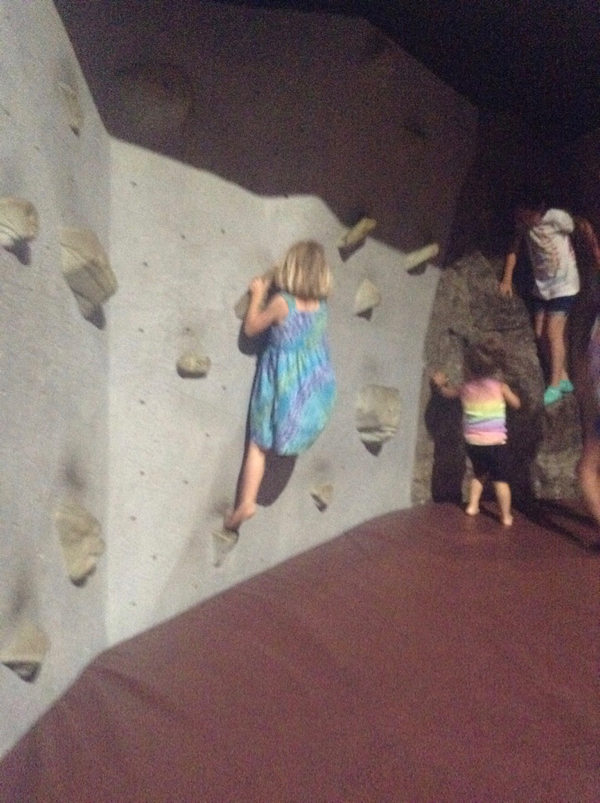 Viv on a climbing wall.