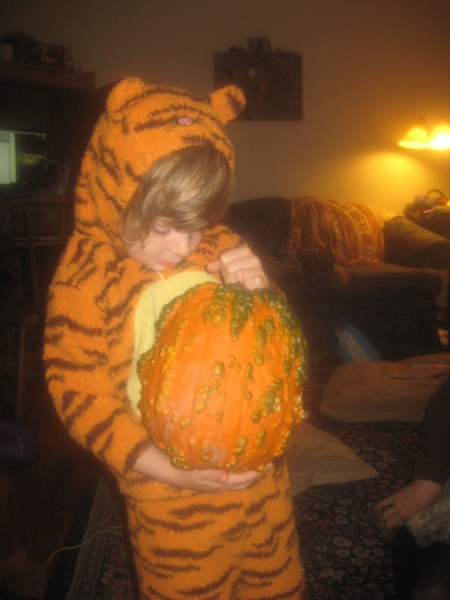 Oscar in tiger suit with lumpy pumpkin