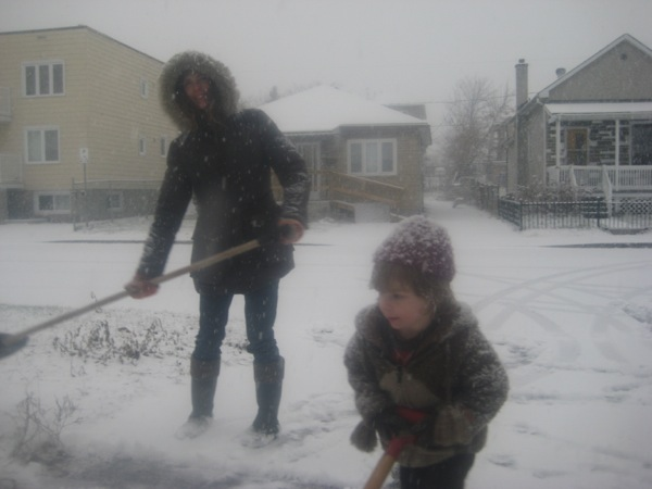 Elizabeth and Oscar shovelling the driveway
