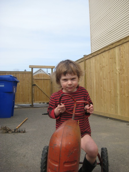 Oscar on his tractor tricycle